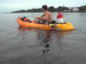 boy fishing in sit-in kayak
