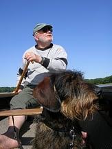 man, dog & canoe