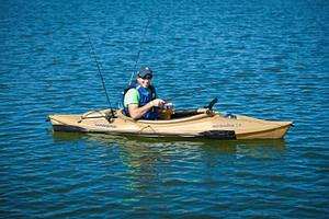 smiling man fishing in sun dolphin kayak